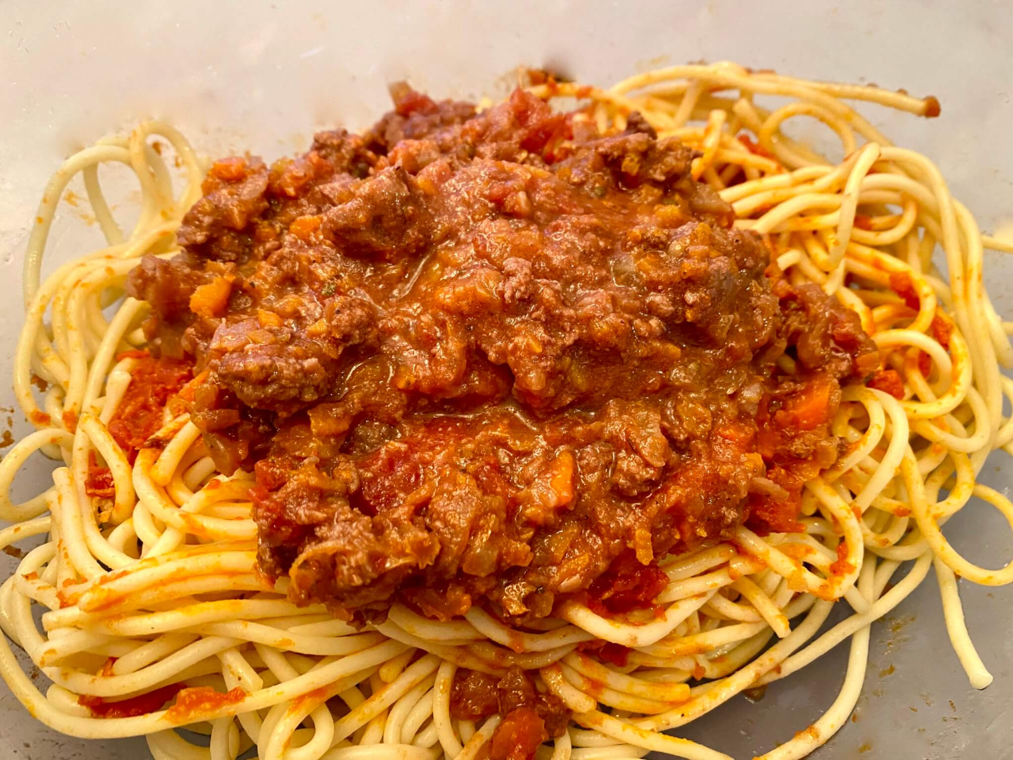 This tomato-based meat sauce is easy to prepare and makes for a memorable pasta dinner. It freezes well, too!