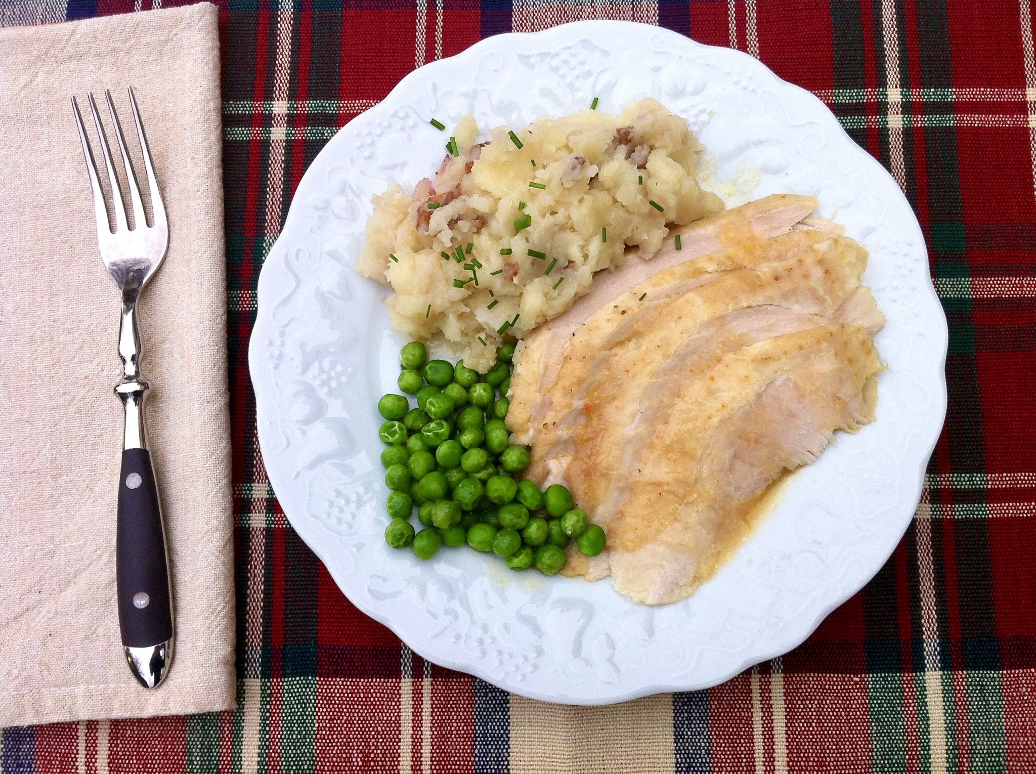 This hands-off, foolproof way to achieve tender, juicy white meat can be prepped the night ahead if desired and the gravy is spectacular.