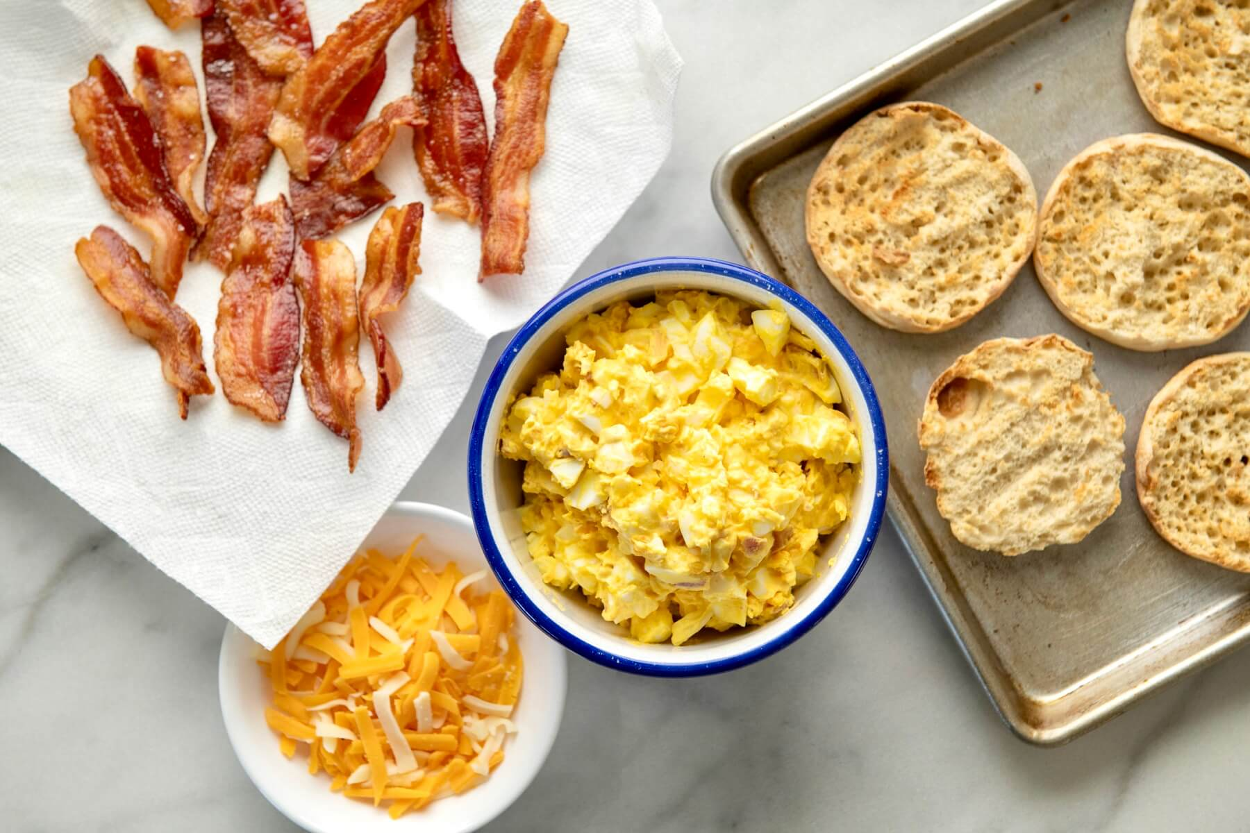 Not your usual egg sandwich, the flavor-packed topping can be prepared in advance and then baked on the bread when ready to eat. Crunchy, creamy, and utterly delicious!