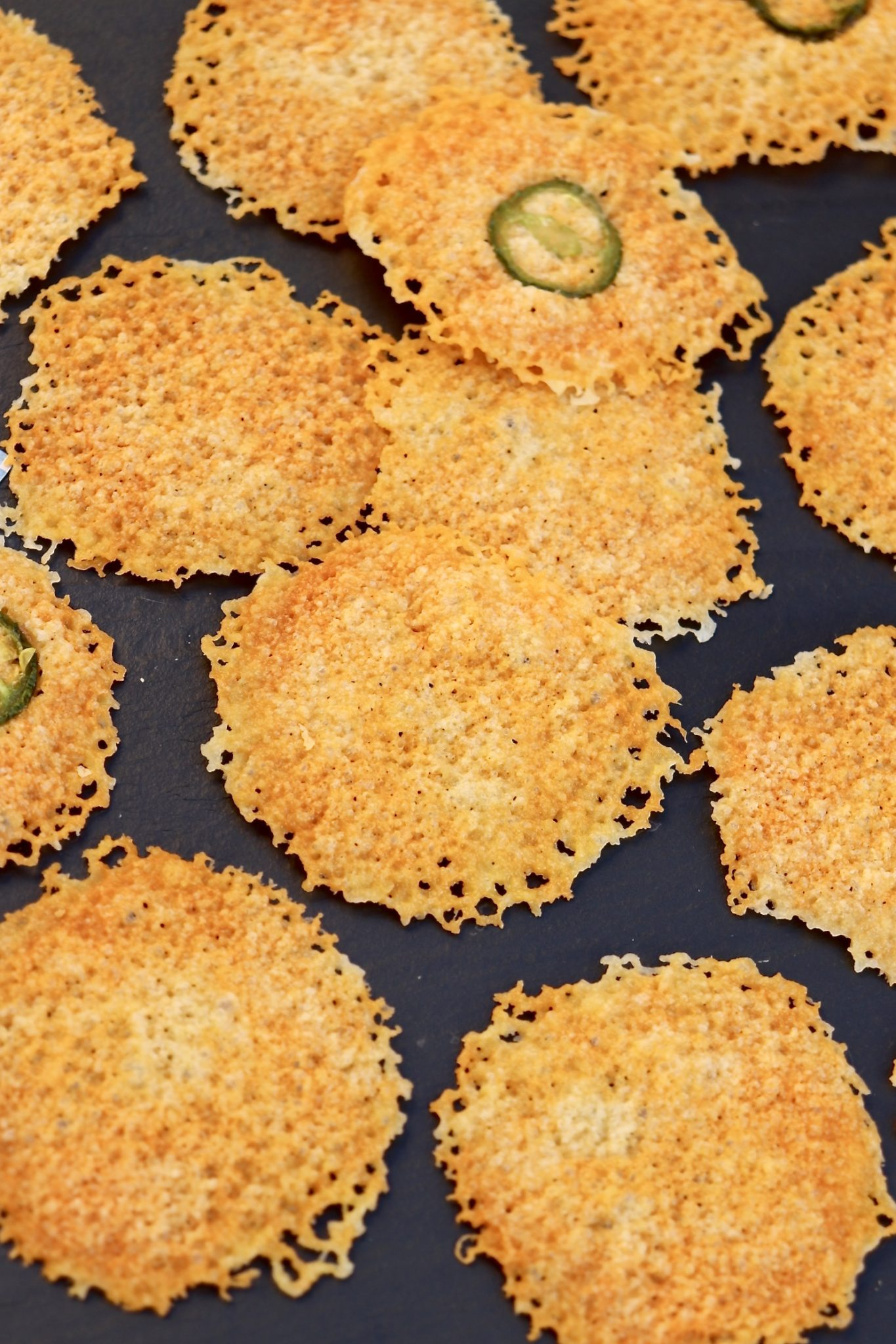 Low-carb cheese crisps require only one ingredient (jalapeño slices are optional) and cook in 2 short minutes – and believe it or not the microwave produces better results than the oven. Perfect with a glass of wine or as a flavorful option to a crouton.
