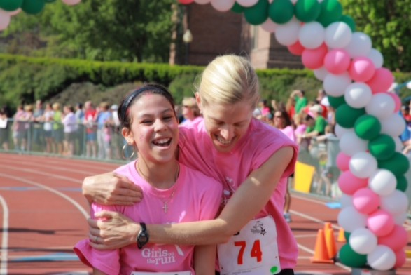 Crossing the finish line with my running buddy…a proud moment!