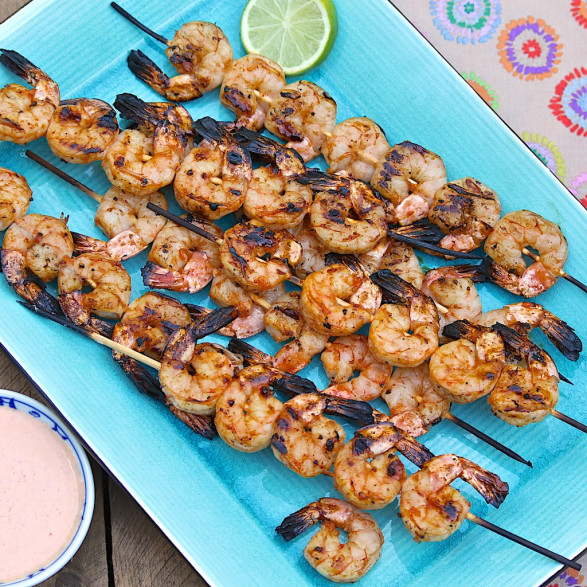 For a crowd-pleasing appetizer option, remove the cooked shrimp from the skewers to a platter. Optionally, thread one or two shrimp onto shorter skewers and leave on the skewers for guests to pick up and enjoy. The shrimp may be served hot or at room temperature.