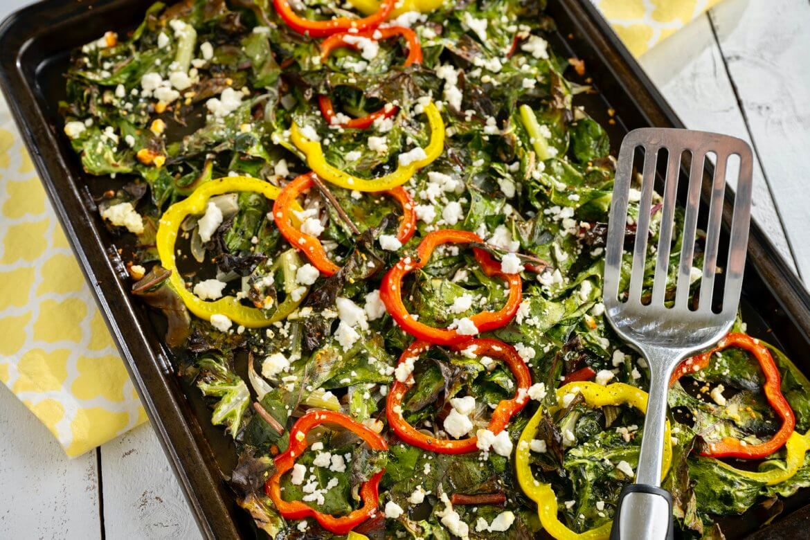 Crave-worthy greens are easy thanks to this unique method of preparation that delivers crisps edges and golden brown bits of feta...all while adding a few other colorful veggies to the mix