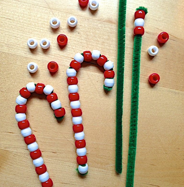There are so many fun craft ideas for the holidays. These candy canes are fun present toppers and great gifts for kids to give to their friends. The fun activity is also great for hand-eye coordination. Don't miss the clever snowman pin, too!