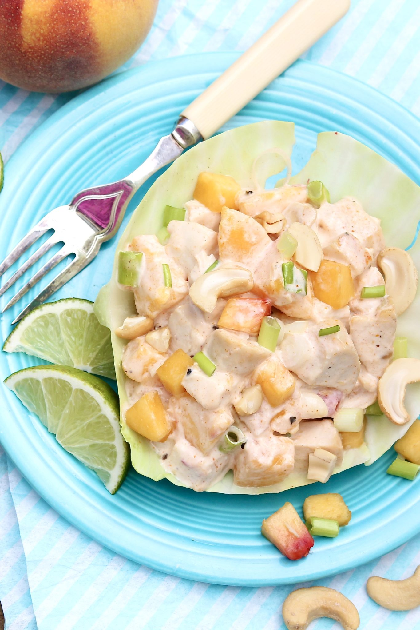 Several of the ingredients in this fresh-tasting chicken salad may be unexpected, but the combination really works! For added ease, leftover grilled, baked, or rotisserie chicken may be used.