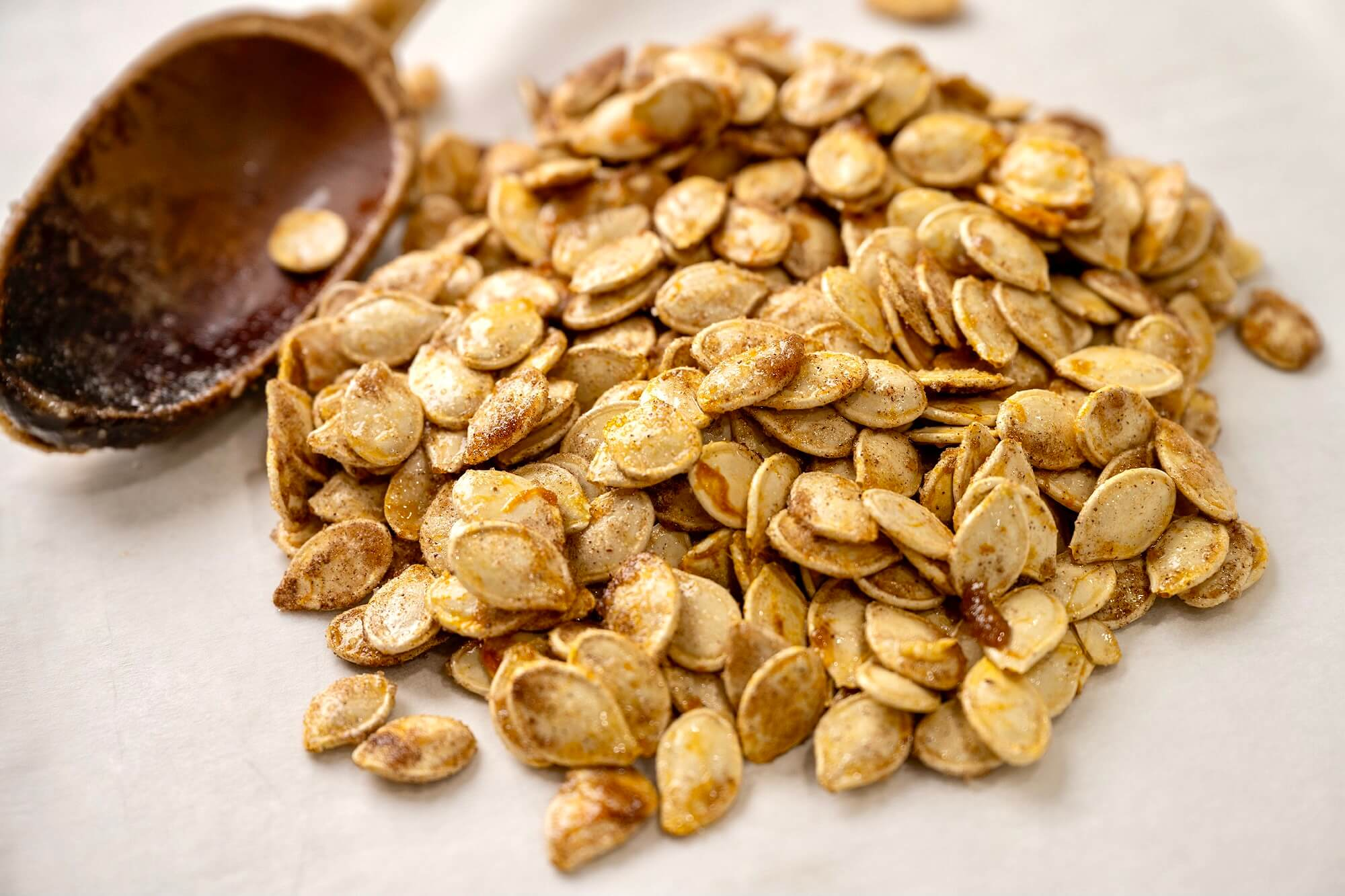 Sugar and spice and everything nice, these crispy seeds offer a snack-worthy way to make the most of your annual pumpkin carving ritual. Taking the time to dry out the seeds, as described in the recipe notes, will create the crispiest, most flavorful seeds.