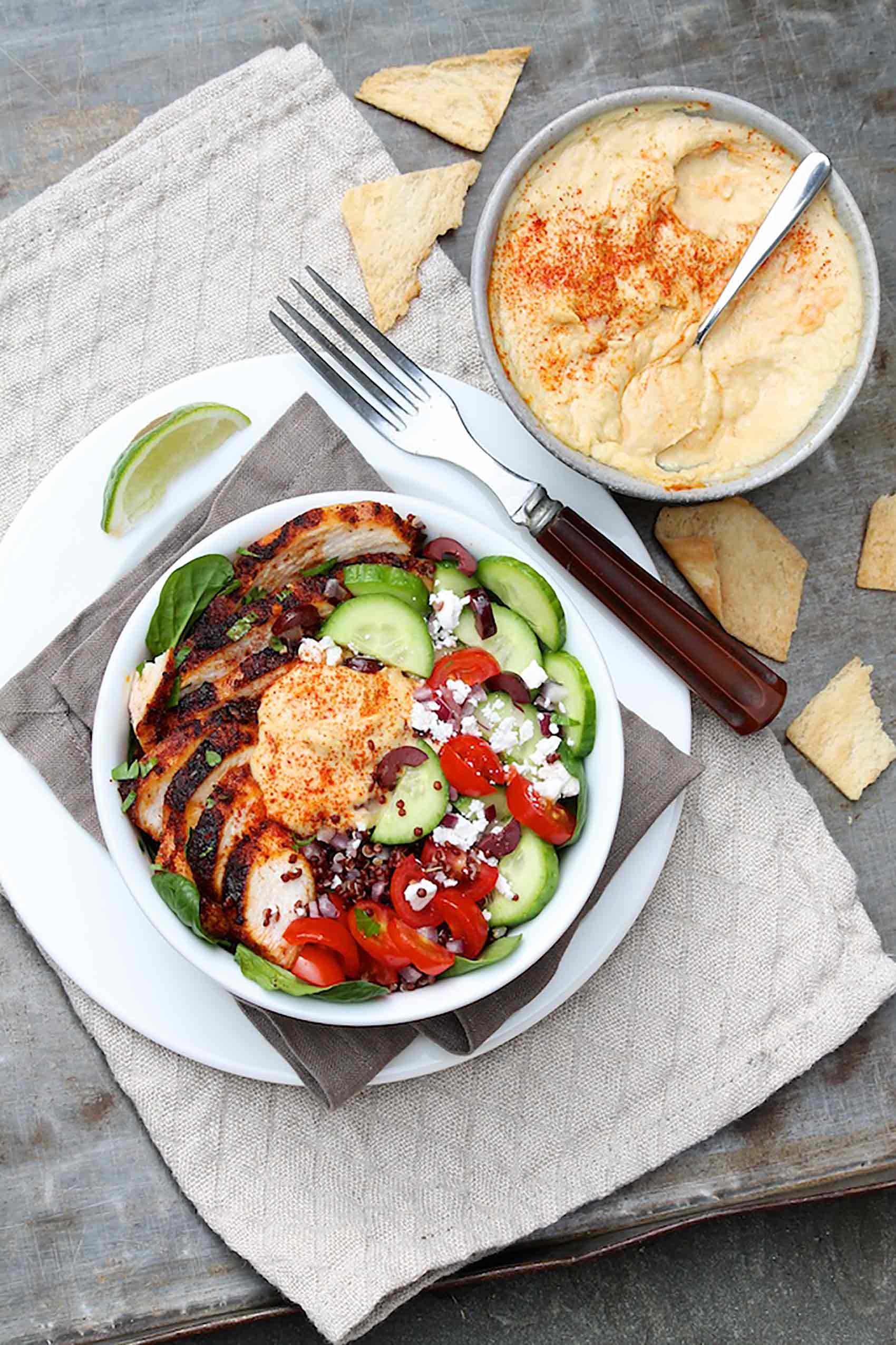 Mediterranean Chicken & Hummus Bowls are easy to assemble, loaded with filling protein and bursting with flavor.