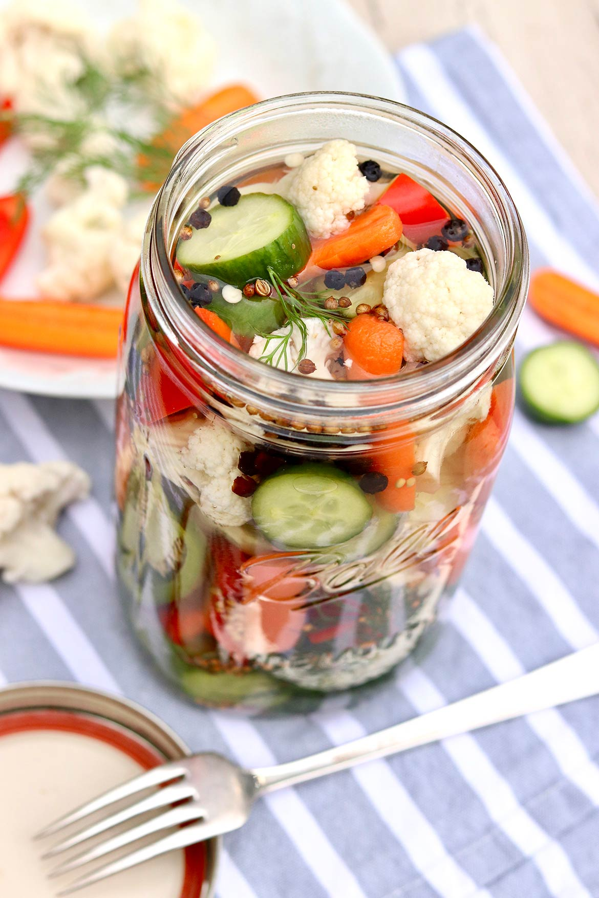 This quick and easy refrigerator method requires no canner or hot water bath and is a clever way to use any odds and ends in your produce drawer!