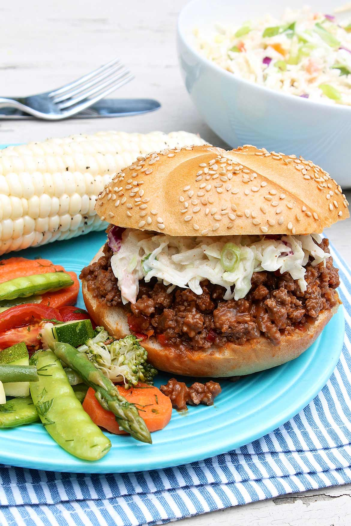 Cumin Lime Coleslaw piled on saucy barbecue sandwiches for the win!