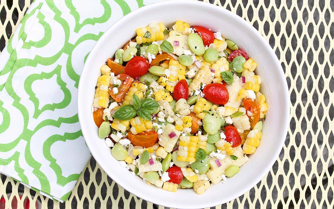 """Succotash Salad is fresh, simple summer eating at its best. The simplicity of the """"dressing""""—really just a drizzle of olive oil and a squeeze of lemon—allows the flavors of the seasonal produce to shine.Leftovers make a great lunch!"""