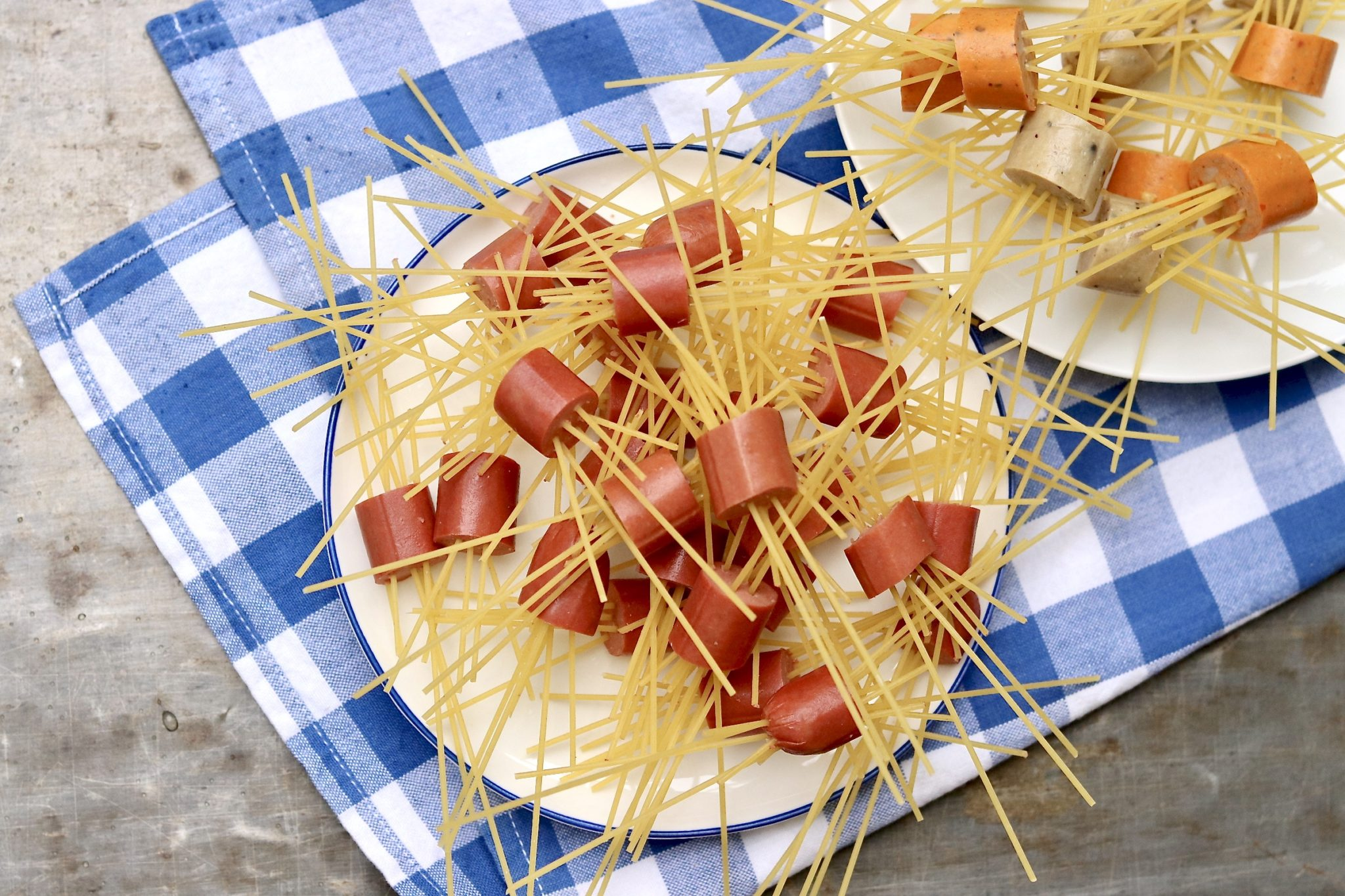 """Move over meatballs! This squirmy pasta dish makes a fun project for kids and a crowd-pleasing Halloween-themed meal. For a more """"mature"""" version, substitute your favorite cooked sausage for the hot dogs."""