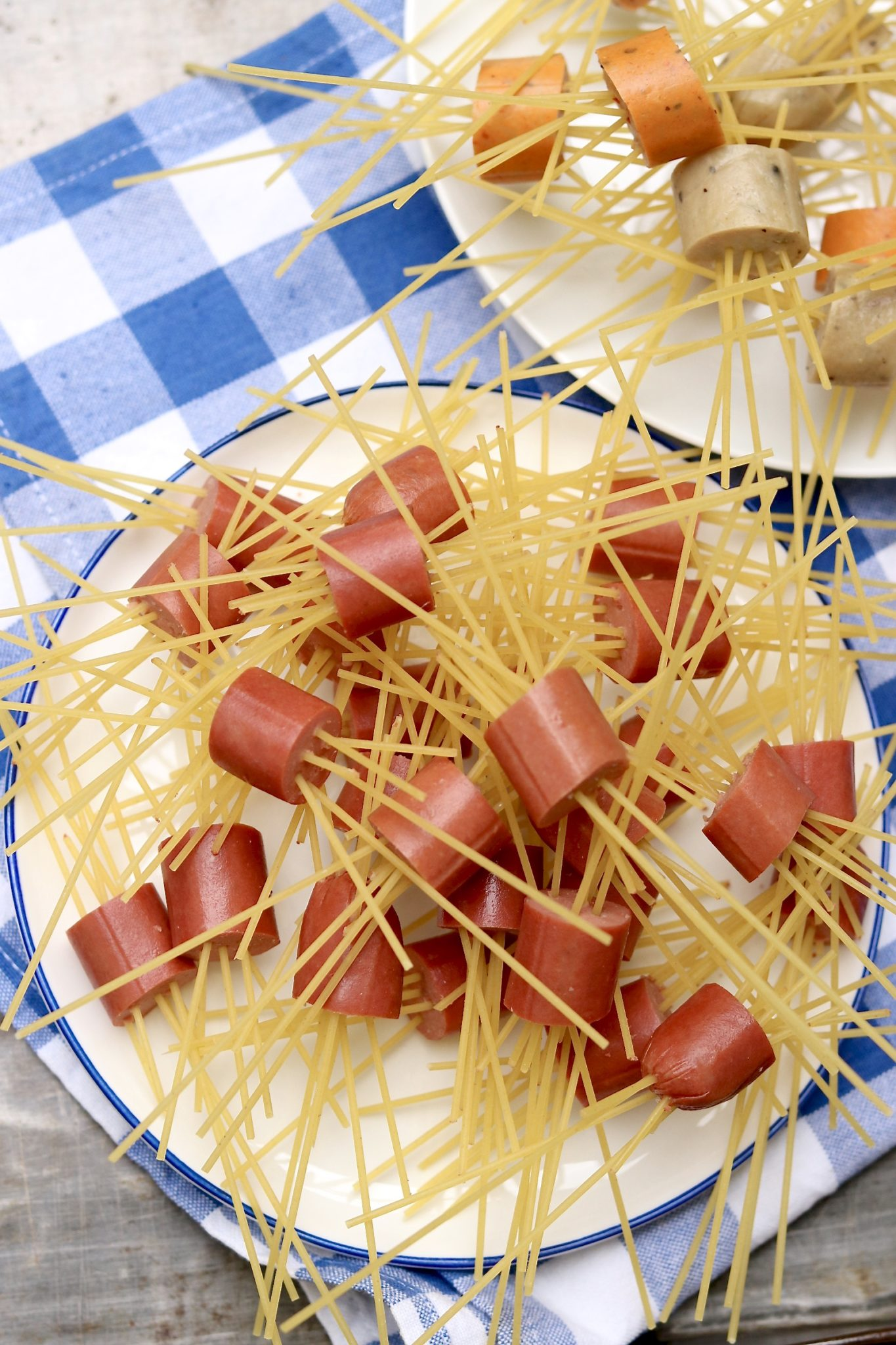 "Move over meatballs! This squirmy pasta dish makes a fun project for kids and a crowd-pleasing Halloween-themed meal. For a more ""mature"" version, substitute your favorite cooked sausage for the hot dogs."