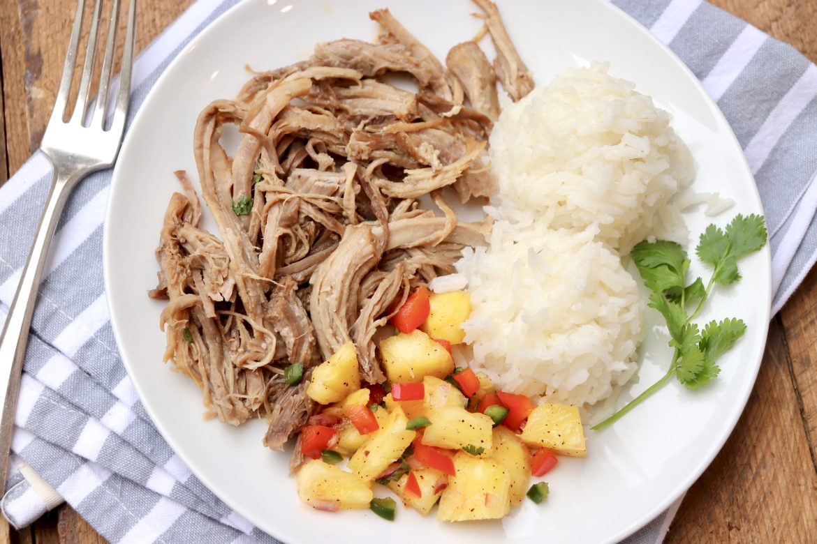 This easy, melt-in-your-mouth Kalua Pork recipe comes with Instant Pot and slow cooker options PLUS everything you wanted to know about electric pressure cookers!