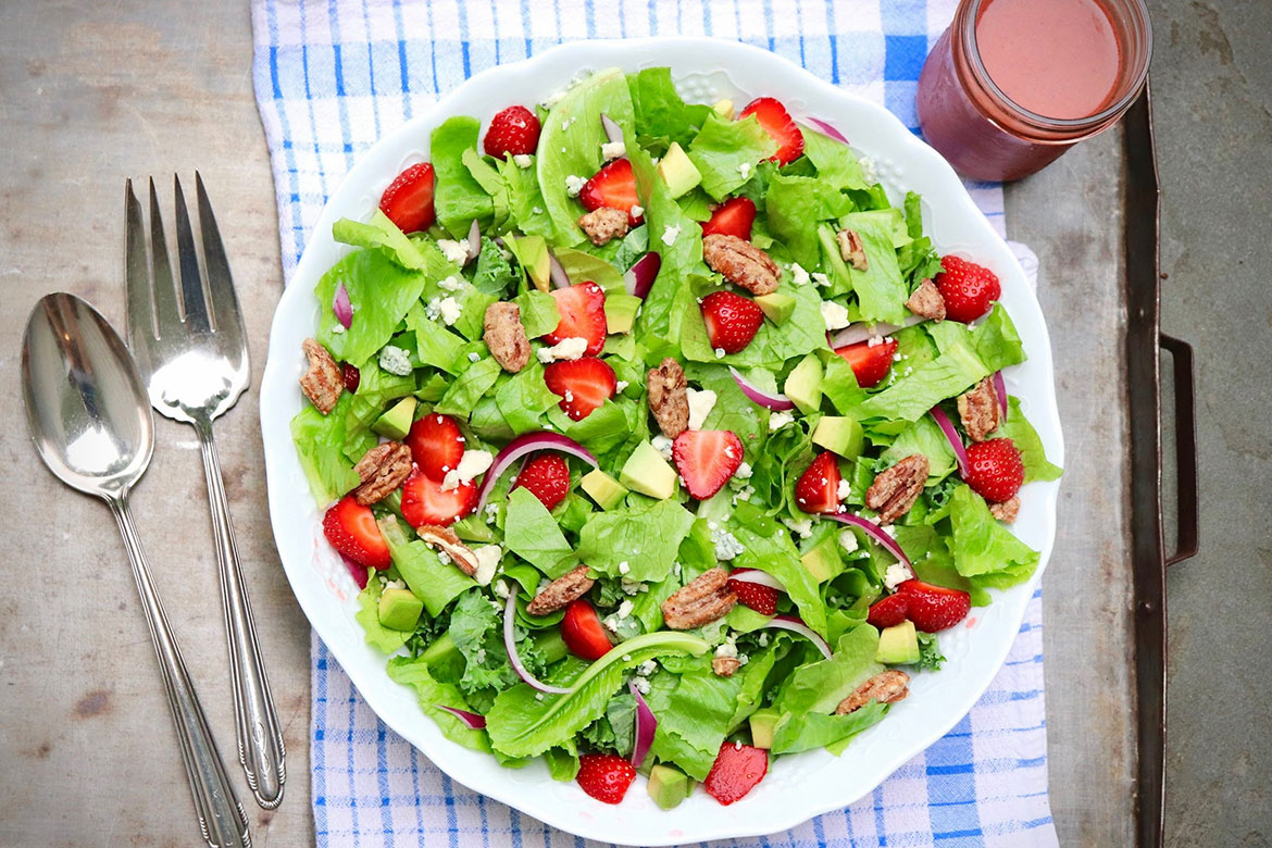 Favorite Strawberry Salad-The luxuriously creamy (yet healthy!) sweet-tart dressing makes this seasonal salad a standout. Virtually any protein will complete the meal.