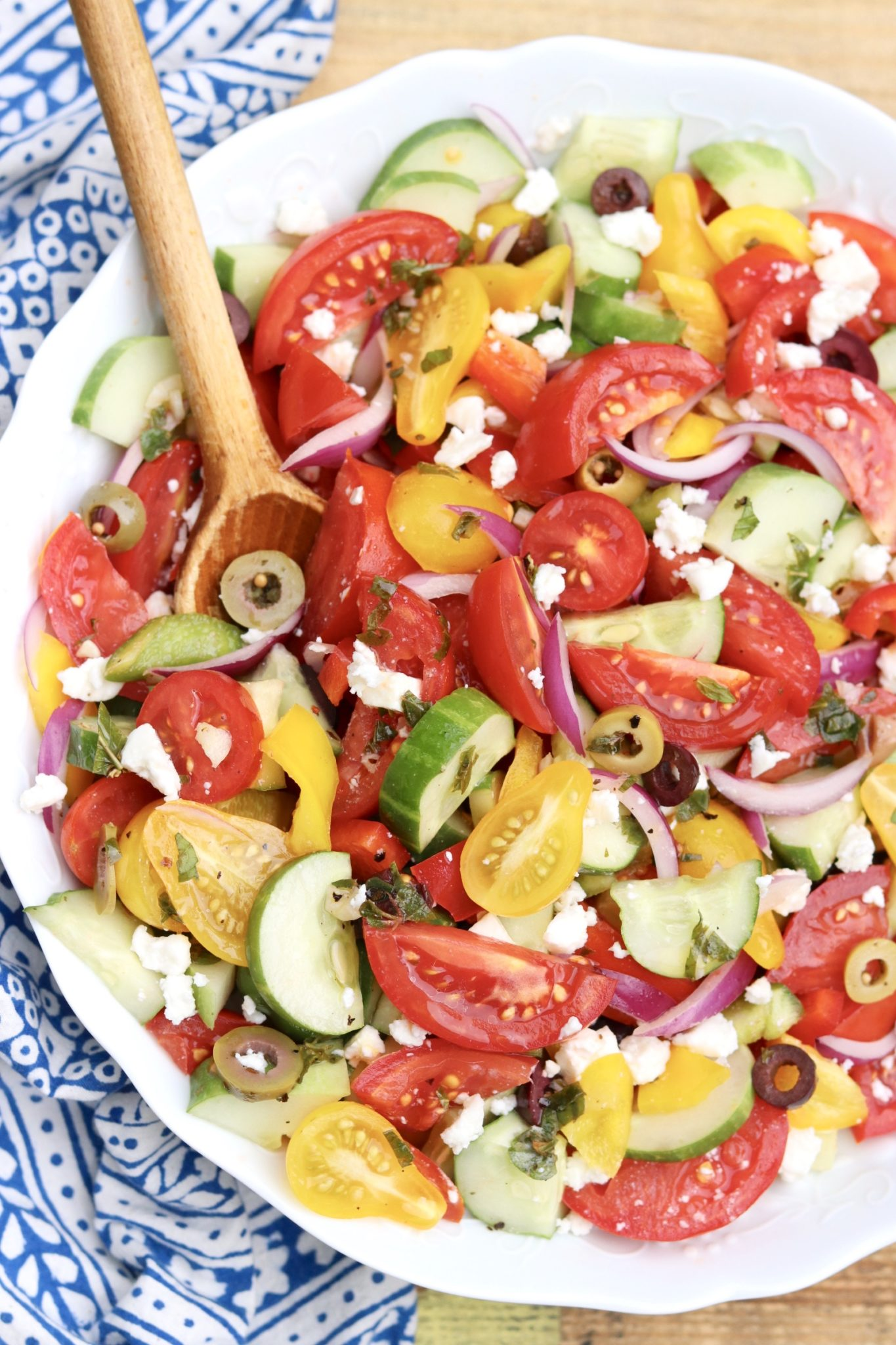 Greek Village Salad- Arustic combination of garden vegetables, feta cheese and kalamata olives (but no lettuce!) tossed with a vinaigrette that will transport you to Greece.