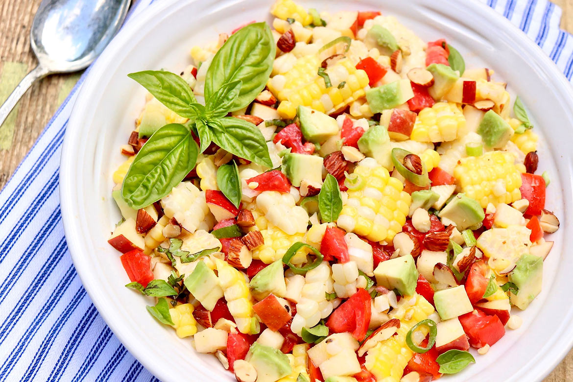 NAPA SWEET CORN SALAD-An unexpected ingredient adds crisp crunch to a classic corn salad, and the easy vinaigrette pulls it all together. Perfect for summer and fall meals!