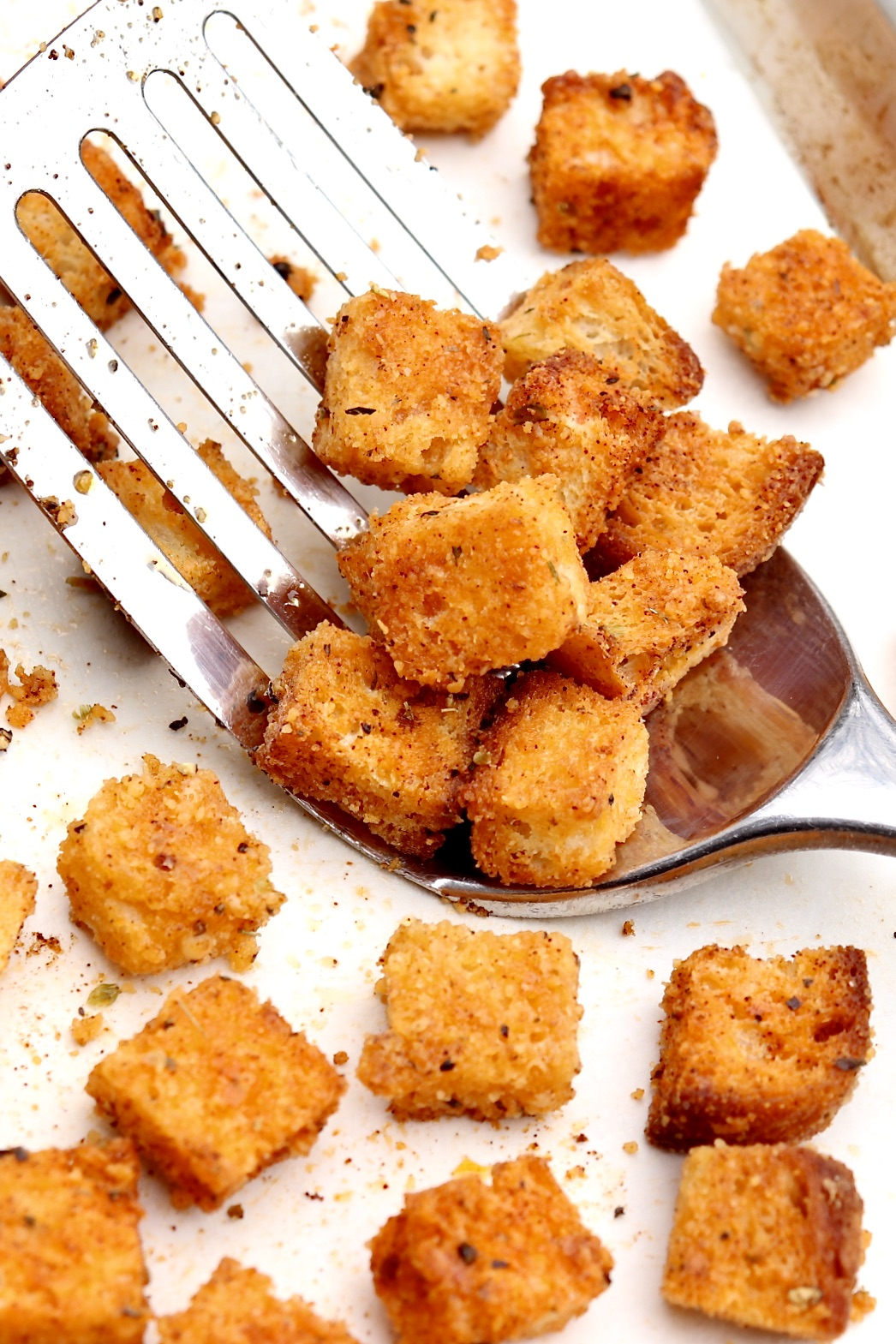 A simple mix of herbs, spices, olive oil and Parmesan makes snack-worthy croutons that add crisp crunch to soups, salads, casseroles and more. The flavor-packed bites offer a practical way to make use of leftover bread, from baguettes to sturdy sandwich bread, with an excellent gluten-free option.
