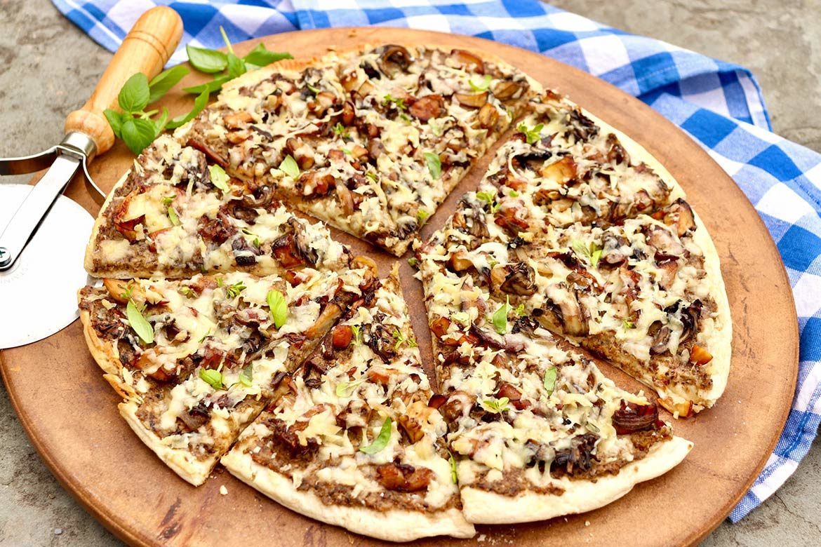 """The flavor-packed """"sauce"""" and topping of this unconventional pizza can be prepared in advance so the pizza can be simply assembled and baked when ready to eat. Even those who dislike mushrooms have fought over the last slice!"""