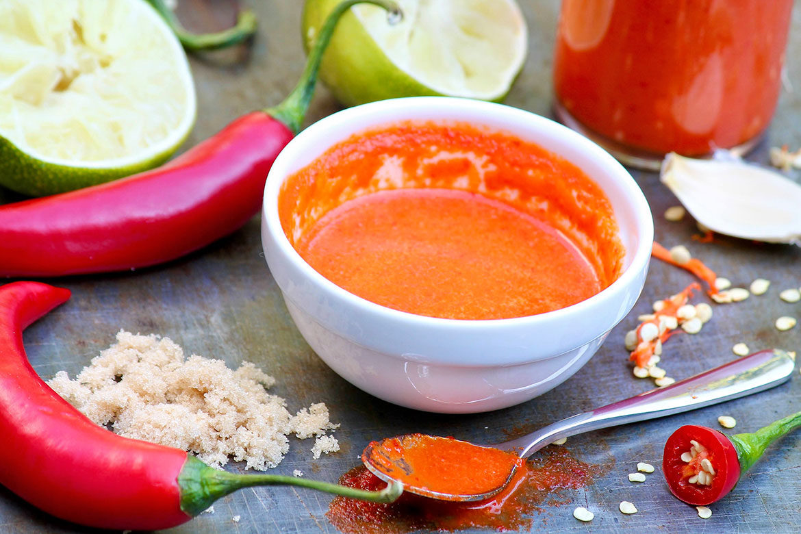 A handful of fresh chile peppers and a few simple ingredients come together beautifully in this not-too-hot sauce that can be slathered on so many things!