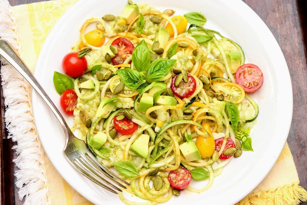 A bowlful of zucchini noodles serves as a low-carb base for all sorts of flavors, textures, and colorful additions - but you need not be counting carbs to adore this meal!