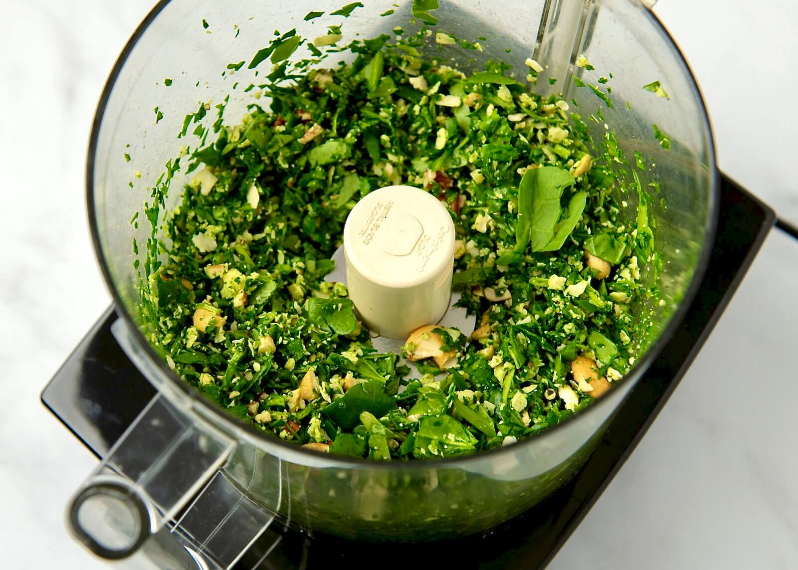Easy, accessible, and endlessly versatile, this flavorful pesto is especially ideal when fresh herbs aren't available. Perfect for adding flavor to pasta, pizza and flatbread, sauces, sandwiches, and so much more, the simple recipe can be customized with a variety of nuts, seeds, and cheeses.Plus it maintains its vibrant green color and freezes well!