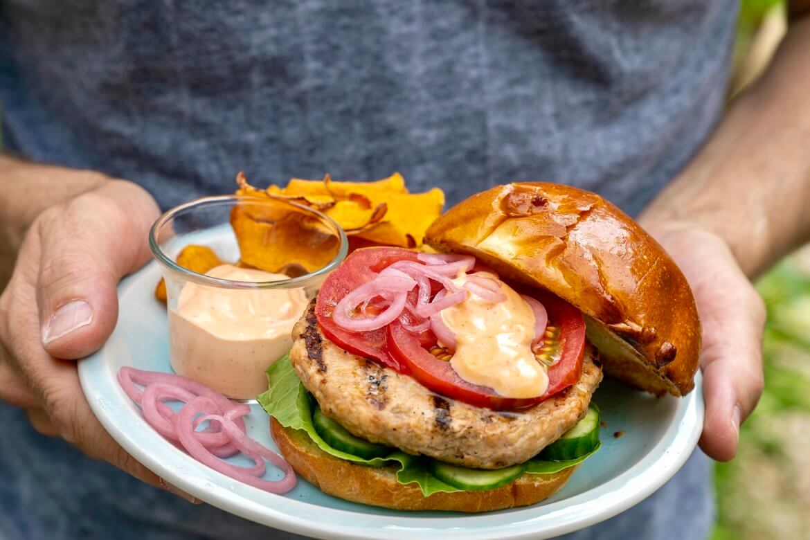 Tender, juicy, flavor-packed turkey burgers are possible with lean breast meat thanks to a few simple additions. A go-to weeknight meal and worthy of a weekend barbecue!