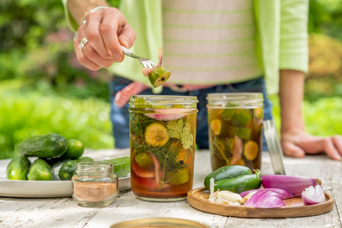 Cool, crisp refrigerator pickles get a new flavor twist in this easy recipe that's perfect for snacking, adding to sandwiches, andserving alongside a variety of barbecue fare. No canning required!