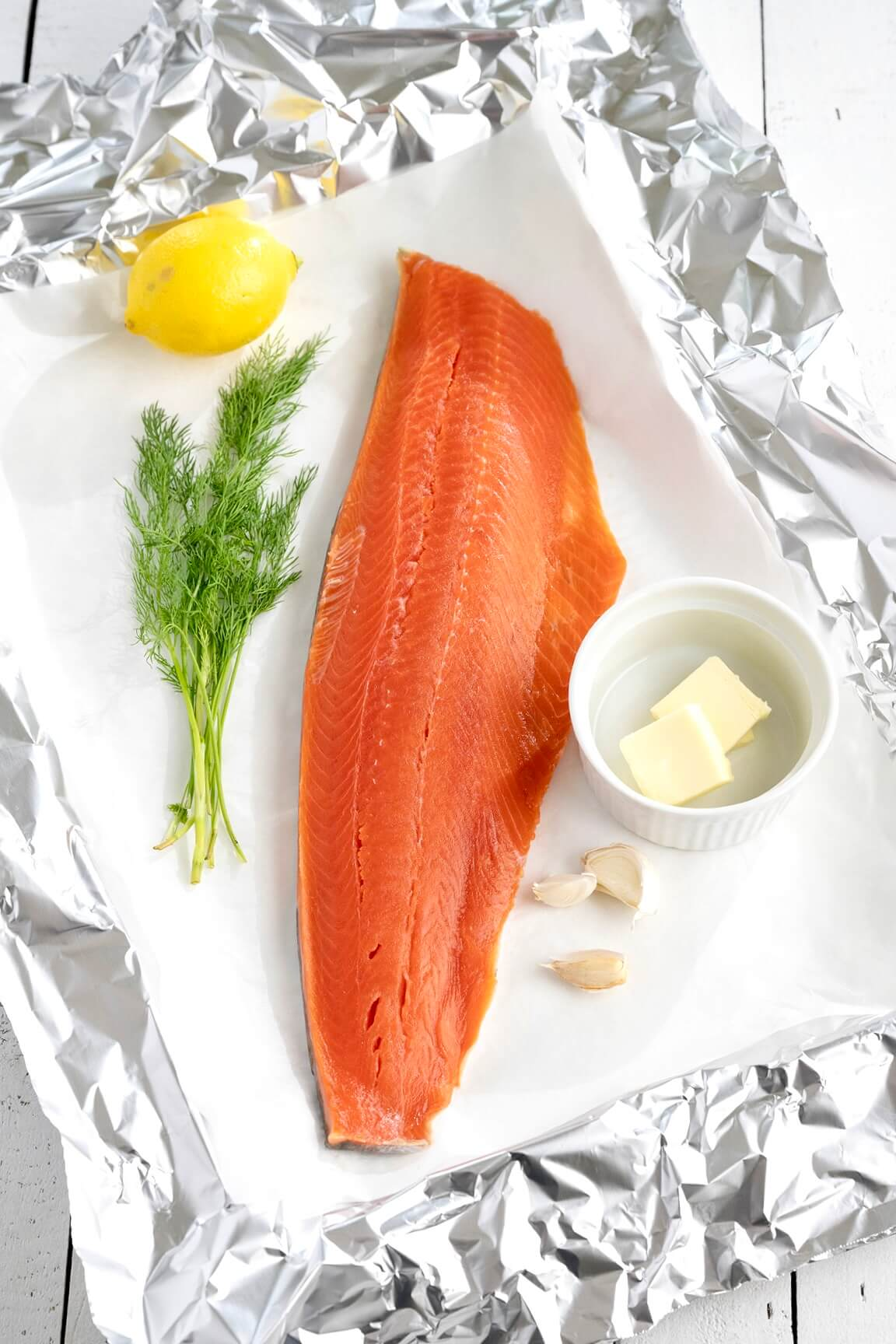 A short list of everyday ingredients makes this easy salmon recipe shine. The simple foil packet locks in flavor and moisture--and makes cleanup a snap!