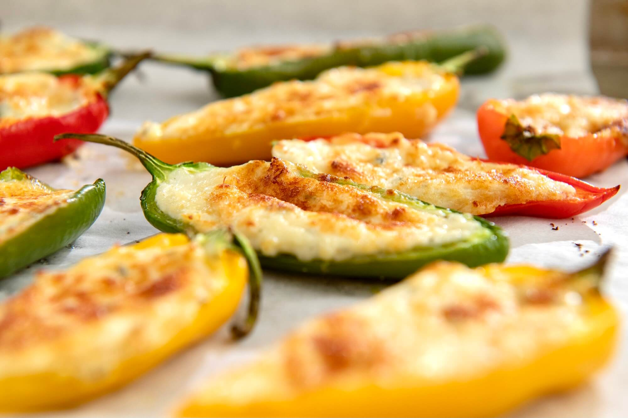 Easy Cheesy Mini Peppers are a delicious appetizer that are essentially a baked, less spicy version of a jalapeño popper...but you can make them as jalapeño poppers if you prefer!