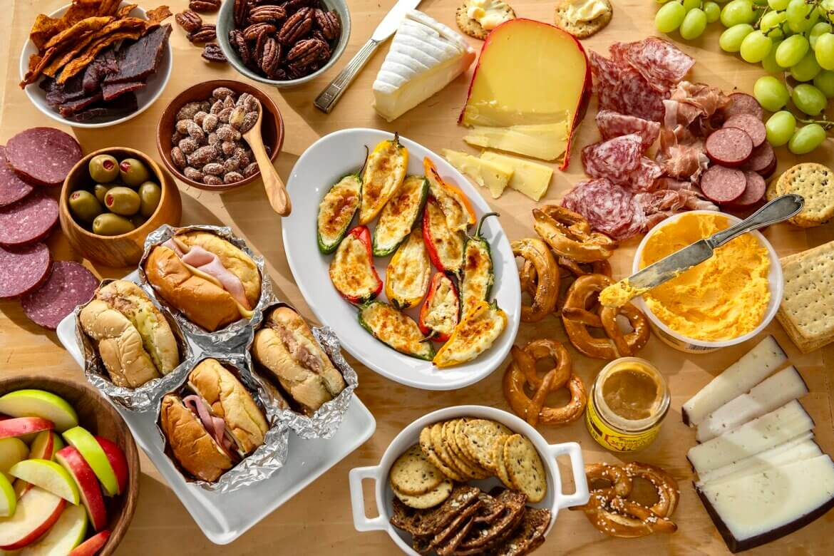 """A deliciously eye-catching charcuterie board is easy to create, and the following suggestions make it a game-day winner. With afew """"bonus"""" additions, you can even make it a meal!"""
