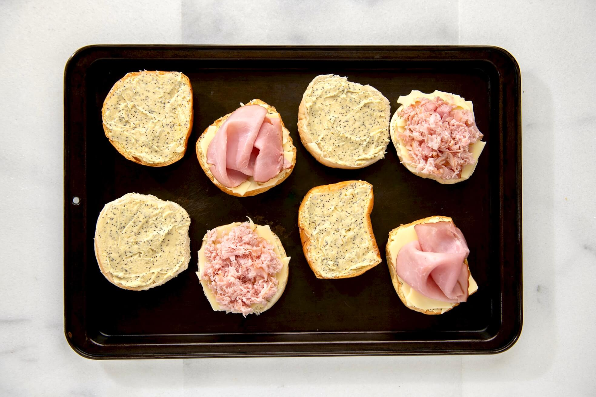 The classic ham sandwich is redefined with two kinds of cheese, a flavorful spread, and a quick trip to the oven. Make-ahead & party perfect!