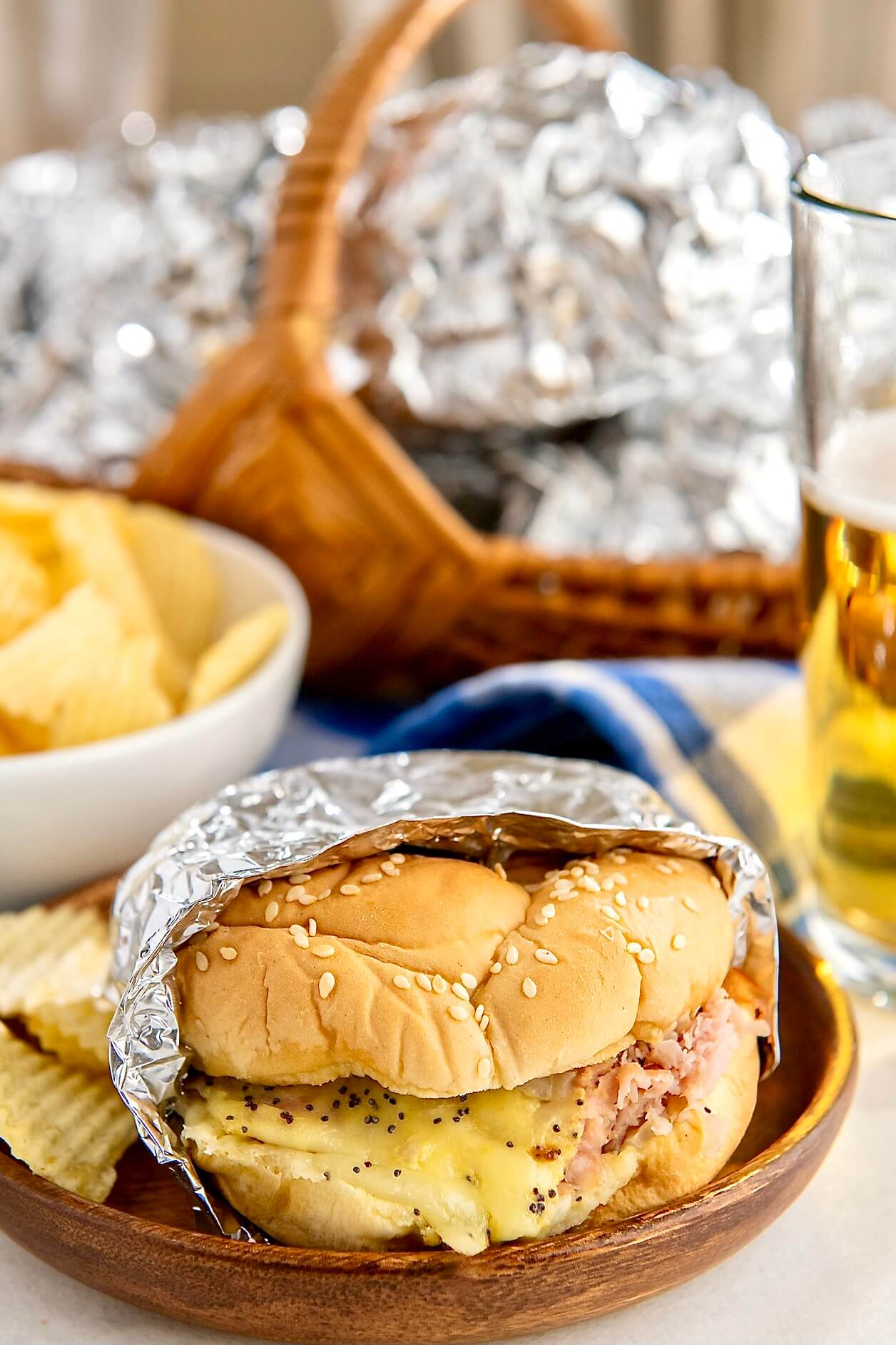 The classic ham sandwich is redefined with two kinds of cheese, a flavorful spread, and a quick trip to the oven. These toasty bunwiches are easy to make ahead and as well suited to casual entertaining as they are to a quick weeknight meal with a side of soup!