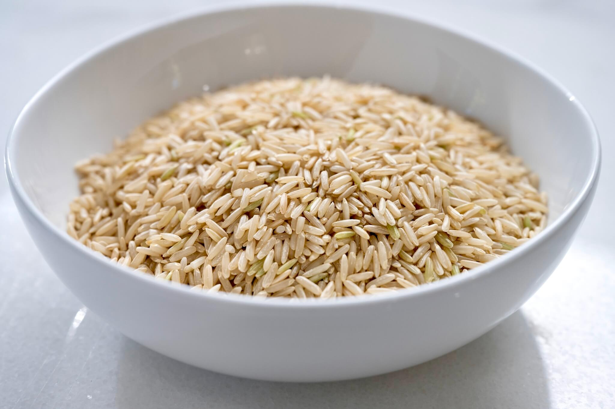 To steam, boil, bake, or use a rice cooker? What's the best way to cook brown rice? This foolproof boiling method produces light, fluffy, plump grains every single time. It's easy, too!